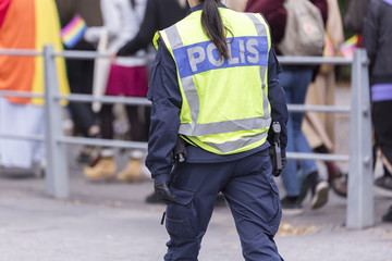 Swedish Police Officer with Reflective Vest and Gun.