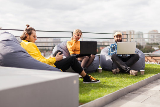 Business lifestyle in the roof garden, creative space. Bean bag chair in office.