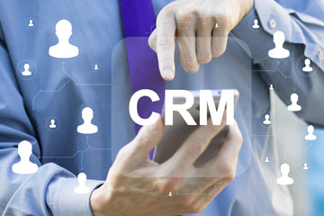 Wall Mural - Businessman click on virtual scheme representing CRM Customer Relationship Management Business.