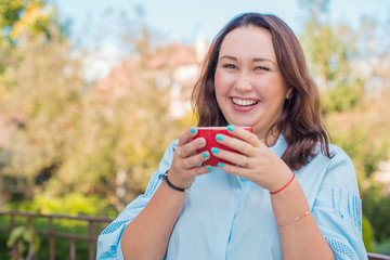 Nice plus size happy american woman at morning with cup of coffee at balcony outdoor. Morning concept. Life of Beautiful Young Asian Woman xl size
