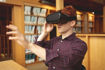 College student using virtual reality headset in library