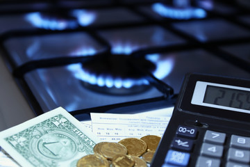 calculator and money in the background of a gas stove