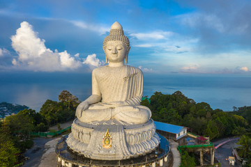 aerial photography scenery blue sky and blue ocean behind Phuket white big Buddha. Phuket white big Buddha is the .famous landmark in Phuket island  a lot of tourists visiting this landmark every day
