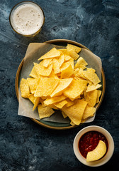 Mexican nachos with  tomato ketchup sauce. Mexican food concept. Yellow corn totopos chips with sauce