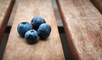 Fresh blueberries on brown wooden table