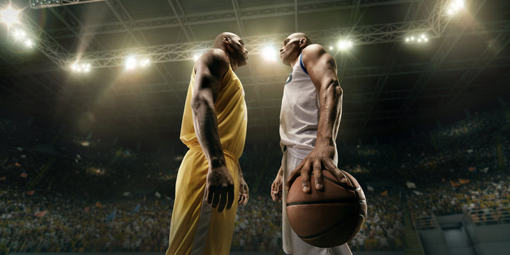 Two black basketball players on big professional arena before the game. Two teams. Players collided face to face. Player holds a ball