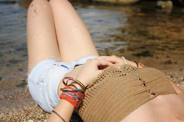 Female hands with many boho bracelets, outdoor