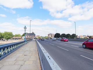 Light morning commuter traffic crossing Trent Bridge in Nottingham