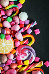 different sets on a black background, candy, chewing gum, candy on black background