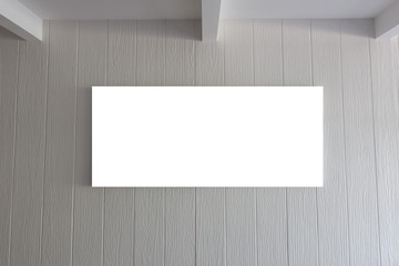 Blank frame on vintage white wooden wall