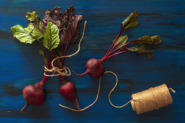 Pile of homegrown organic young beets with green leaves