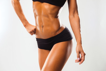 Perfect Fitness Body of Beautiful Woman. Female Model with Fit Muscular and Slim Body in Sportswear. CloseUp