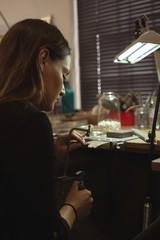 Jewelry designer making jewelry in workshop