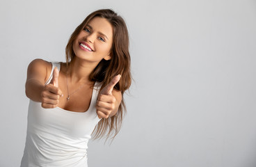girl enjoys success and shows a gesture of luck