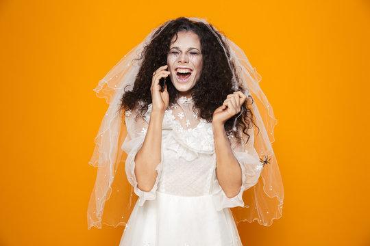 Happy woman zombie talking on smartphone