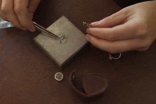 Jewelry designer working in workshop