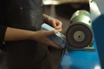 Jewelry designer using sharpening machine