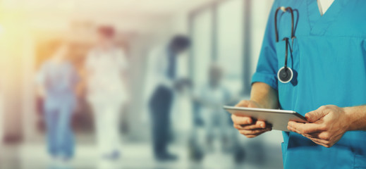 Concept of global medicine and healthcare. Doctor holds digital tablet. Diagnostics and modern technology in hospital
