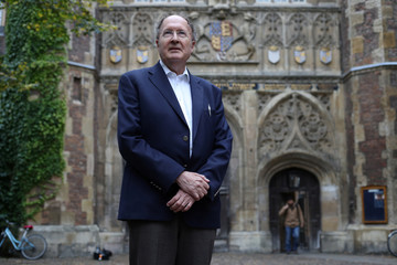 Gregory Winter, poses for photographs after being awarded the Nobel Prize for Chemistry, outside Trinity College Cambridge