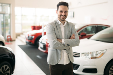 Portrait of happy customer buying new car