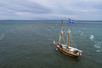 Old sail boat approching Port of Montreal on the St-Lawrence River