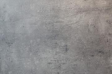 Graue Wand mit einer Betonstruktur