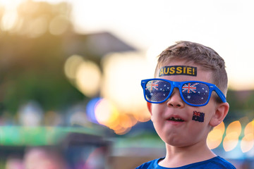 Cute Australian boy with flag tattoo on his face