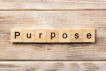 purpose word written on wood block. purpose text on table, concept Wall mural