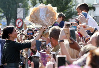 Britain's Meghan, Duchess of Sussex receives a bunch of flowers from well-wishers during a visit  to the Royal Pavilion in Brighton