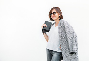 Wall Mural - Woman in monochrome casual outfit with checkered jacket