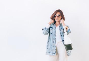 Wall Mural - Elegant woman dressed in oversize denim jacket
