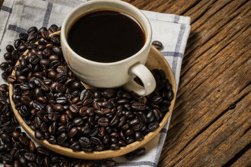 A coffee bean is a seed of the coffee plant and the source for coffee.