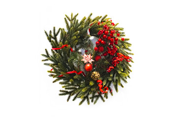 christmas wreath new year isolated on white background. beautiful spruce wreath with red flowers, balls, berries and stars