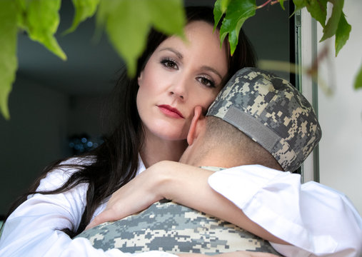 Worried wife holding soldier husband or partner