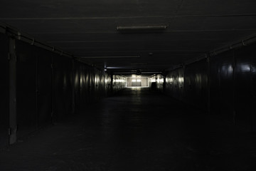 dark corridor with light at the end