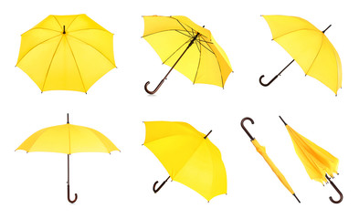 Wall Mural - Set with elegant yellow umbrella from different views on white background