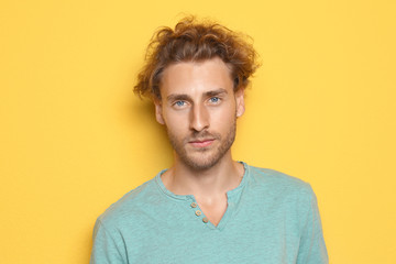 Portrait of young man on color background