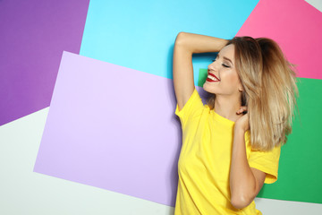 Beautiful young woman with healthy long blonde hair on color background. Space for text