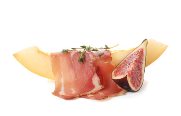 Melon slice with prosciutto and fig on white background