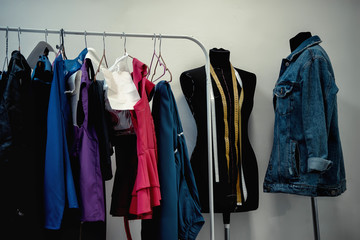 clothes hanging on the hanger in the dressing room