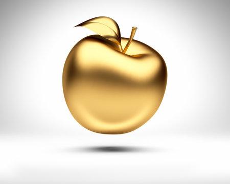 Goldener Apfel vor Weiß
