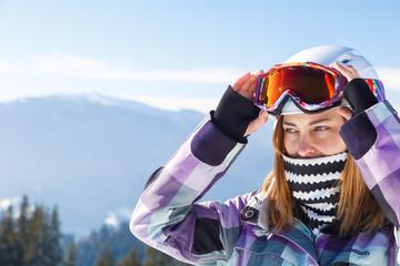 Skier girl on the background of high mountain Carpathians in Ukraine. Winter sport.