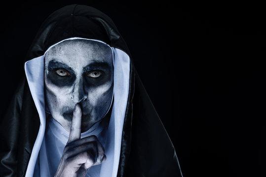 frightening evil nun asking for silence