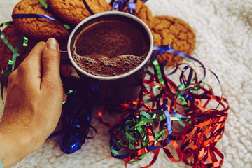 Printed kitchen splashbacks Spices New Year and Christmas. Serpentine and garlands. Ginger and oatmeal cookies. New Year sweets. White background.Hot coffe on dark cup and hand.