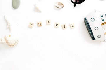 Travel composition with toy boat, seashells on white background. Flat lay, top view minimal blog hero header.