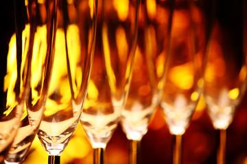 Empty champagne glass gold bokeh studio