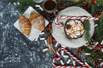 Winter hot drink. Chocolate or cocoa with marshmallow, cookies, candy on dark background . Flat Lay.