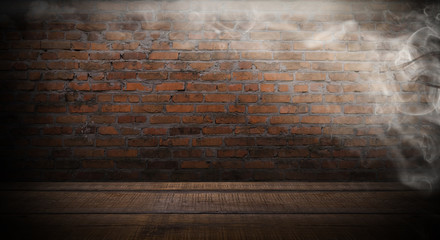 background of an empty black room, a cellar, lit by a searchlight. Brick black wall, smoke.