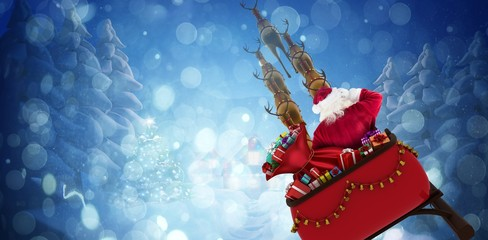 Composite image of rear view of santa claus riding on sled