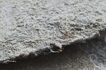 Detailed photography of roof covering material with asbestos fibres. Health harmful and hazards effects. Prolonged inhalation of microscopical fibers causes fatal illnesses including lung cancer.